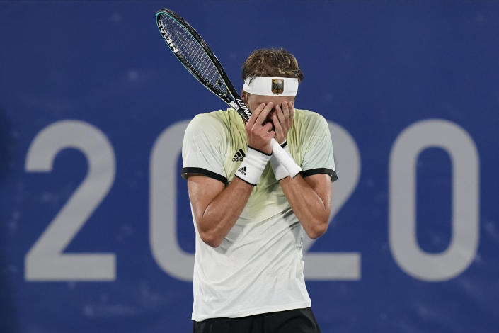Alexander Zverev, of Germany, reacts after defeating Novak Djokovic, of Serbia, during the semifinal round of the men's tennis competition at the 2020 Summer Olympics, Friday, July 30, 2021, in Tokyo, Japan. (AP Photo/Patrick Semansky)