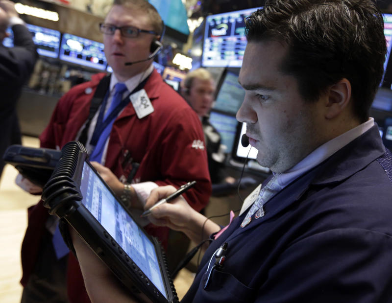 Trader Joseph Lawler, right, works on the floor of the New York Stock Exchange Tuesday, March 12, 2013.  Stocks are edging lower on Wall Street in early trading following a seven-day rally. (AP Photo/Richard Drew)