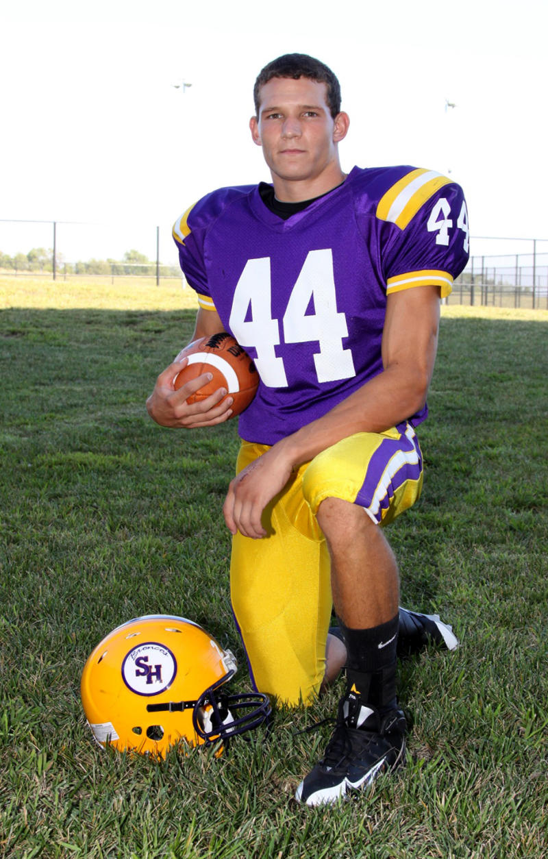 FILE - In this Sept. 2, 2010, photo provided by PEC Sports, senior football player Nathan Stiles poses on the field at Spring Hill High School in Spring Hill, Kan. Stiles died last month of an undetected subdural hematoma, an apparent re-bleed of an earlier  injury. Now, family, school and medical experts are left wondering if anything more could have been done, and how to prevent a similar tragedy.  (AP Photo/PEC Sports, Brock Stubbs) NO SALES