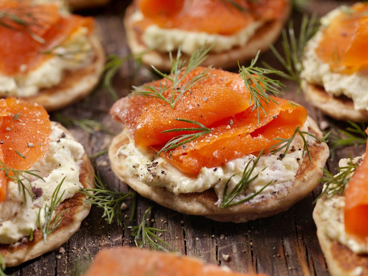 """<p>Smoked <a href=""""https://www.goodhousekeeping.com/uk/food/food-reviews/g29126933/flavoured-smoked-salmon/"""" target=""""_blank"""">salmon</a> shines throughout the <a href=""""https://www.goodhousekeeping.com/uk/christmas/"""" target=""""_blank"""">Christmas</a> period; a great light starter before the <a href=""""https://www.goodhousekeeping.com/uk/food/food-reviews/g23867629/the-best-roast-turkey-for-your-christmas-dinner/"""">turkey</a>, a canapé topping for festive nibbles, or an indulgent addition to your Christmas breakfast.</p><p>Sourced from all over the world, the best smoked salmon is firstly dried and cured before being seasoned or glazed, often with dill, mustard, lemon or garlic (to name a few). The fish is then hot or cold smoked over various woods – typically beech and oak but sometimes maple or birch too – to further enhance the flavour.</p><p>This year, supermarkets and independent suppliers have a great selection on offer. So whether you're doing the Christmas food shop online or heading to your local supermarket, here are the best smoked salmons we think you should buy...</p><h2 class=""""body-h2""""><strong>GHI tip</strong></h2><p><strong></strong>Store your smoked salmon on the bottom shelf of the fridge, where it's the coldest. Unopened, it should remain fresh for weeks but once opened, place in a zip-lock bag or keep it in the original packaging and seal with clingfilm.</p><h2 class=""""body-h2""""><strong>How we test</strong></h2><p><strong></strong>Our consumer panel assessed the appearance, aroma, flavour and texture of each smoked salmon. We were looking for delicately sliced pieces of fish with a healthy colour and appetising marbling throughout. The flavour should offer a delicate smokiness with an even balance of salt, and finish with a slightly sweet, fishy note. Take a look at our winners below.</p><p>Prices subject to change.<strong></strong><br></p><p><a href=""""http://www.goodhousekeeping.co.uk/food/recipes/smoked-salmon-rolls""""></a><strong><strong>   </strong></strong>"""
