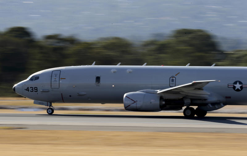A U.S. Navy P-8 Poseidon takes off from Perth Airport on route to rejoin the on-going search operations for the missing Malaysia Airlines Flight 370 in Perth, Australia, Thursday, April 10, 2014. Planes and ships hunting for the missing Malaysian jetliner zeroed in on a targeted patch of the Indian Ocean on Thursday, after a navy ship picked up underwater signals that are consistent with a plane's black box. (AP Photo/Rob Griffith)