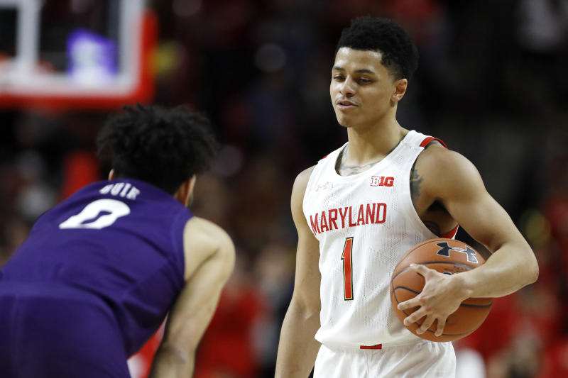 Maryland guard Anthony Cowan Jr. (1) talks with Northwestern guard Boo Buie (0) as they final seconds of the second half of an NCAA college basketball game run out, Tuesday, Feb. 18, 2020, in College Park, Md. Maryland won 76-67. (AP Photo/Julio Cortez)