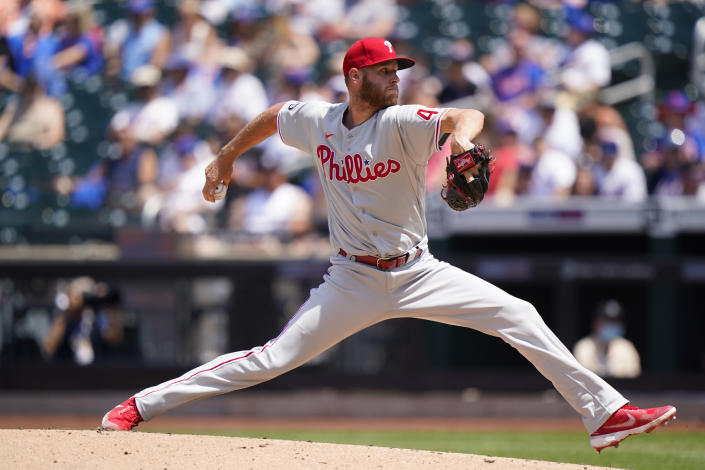 Philadelphia Phillies starting pitcher Zack Wheeler winds up during the third inning of a baseball game against the New York Mets, Sunday, June 27, 2021, in New York. (AP Photo/Kathy Willens)