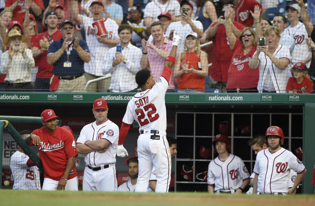 Washington Nationals' Juan Soto (22) takes a curtain call after he hit a three-run home run during the second inning of a baseball game against the San Diego Padres, Monday, May 21, 2018, in Washington. (AP Photo/Nick Wass)