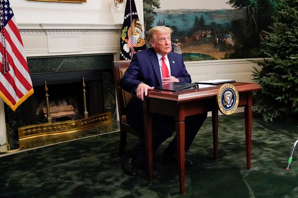U.S. President Donald Trump arrives to a Thanksgiving video teleconference with members of the military forces at the White House in Washington, U.S., November 26, 2020