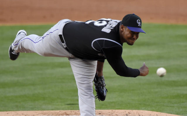 Colorado Rockies starting pitcher Juan Nicasio throws to the plate during the second inning of a baseball game against the Los Angeles Dodgers, Saturday, April 26, 2014, in Los Angeles. (AP Photo/Mark J. Terrill)