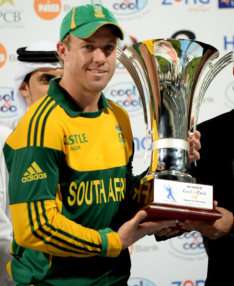 South African captain AB de Villiers holds the trophy after his team won the five-match series against Pakistan in Sharjah Cricket Stadium in Sharjah on November 11, 2013. South Africa beat Pakistan by 117 runs in the fifth and final day-night international in Sharjah on Monday, clinching the five-match series 4-1.   AFP PHOTO/ASIF HASSAN        (Photo credit should read ASIF HASSAN/AFP/Getty Images)
