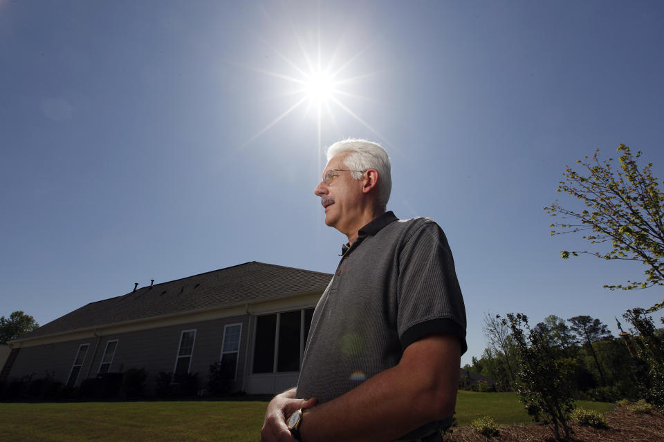 <p> David Dobs poses in front of his home in Cumming, Ga., Monday, April 9, 2012. Dobs' home owners' association denied his request to install solar panels on his roof. Georgia lawmakers narrowly defeated a bill this year that would have prevented homeowners associations from banning solar panels. (AP Photo/John Bazemore) </p>