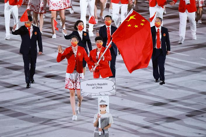 TOKYO, JAPAN - JULY 23: Flag bearers Zhu Ting and Zhao Shuai of Team China take part in the Parade of Nations during the Opening Ceremony of the Tokyo 2020 Olympic Games at Olympic Stadium on July 23, 2021 in Tokyo, Japan. (Photo by Lu Lin/CHINASPORTS/VCG via Getty Images)