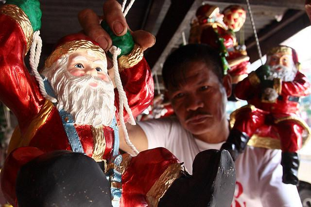A vendor arranges Santa claus statue displayed for sale along Brgy. Tanong in Marikina City, Philippines as Christmas season nears. Christmas in the Philippines has earned the distinction of celebrating the world's longest Christmas season, with Christmas carols heard as early as September and the season lasting up until Epiphany, the feast of the Black Nazarene on January 9 or the Feast of the Santo Niño held every third Sunday of January. (Jerome Ascano/NPPA Images)