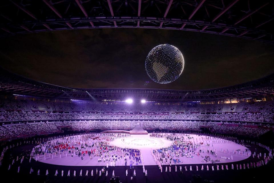 A drone display is seen over the top of the stadium during the opening ceremony.