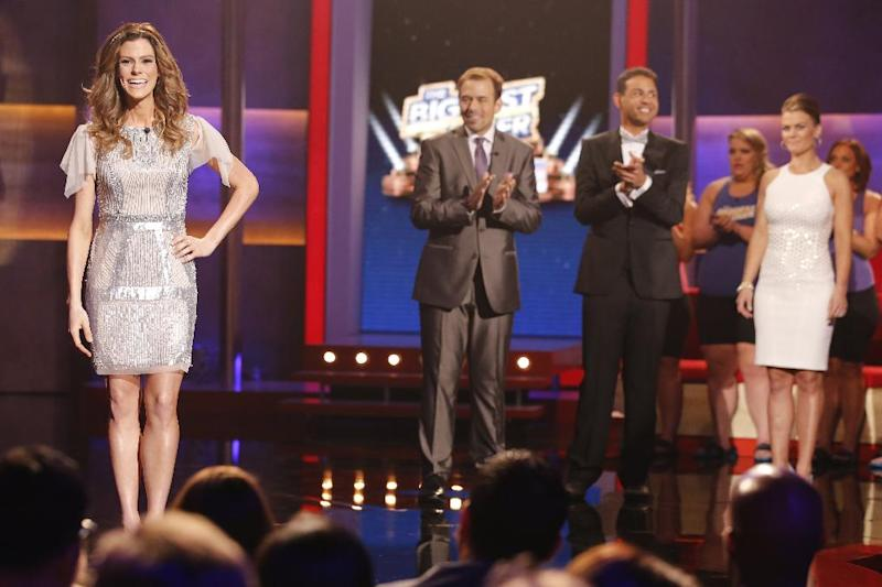 """This Feb. 4, 2014 photo released by NBC shows, from left, Rachel Frederickson, David Brown, Bobby Saleem, and host Alison Sweeney on the finale of """"The Biggest Loser,"""" in Los Angeles. Fredrickson lost nearly 60 percent of her body weight to win the latest season of """"The Biggest Loser"""" and pocket $250,000. A day after her grand unveiling on NBC, she faced a firestorm of criticism in social media from people who said she went too far. (AP Photo/NBC, Trae Patton)"""