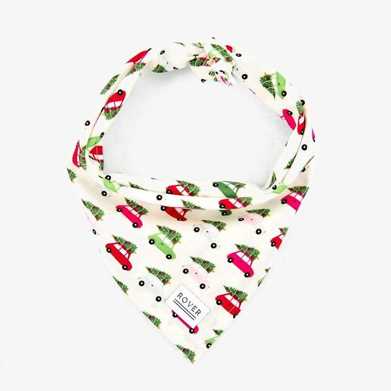 """There were so many cute options it was hard to pick just one but we think this bandana, featuring cars hauling Christmas trees, is adorable. <a href=""""https://theroverboutique.com/collections/dog-bandanas-1/products/dog-bandana-holiday-cars"""" target=""""_blank"""" rel=""""noopener noreferrer"""">Get it for $29.09 at The Rover Boutique.</a>"""