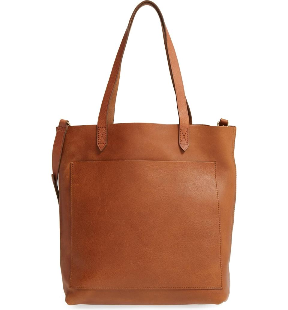 <p>This gorgeous <span>Madewell Medium Leather Transport Tote</span> ($158) can hold everything you need to go from work to drinks with friends.</p>