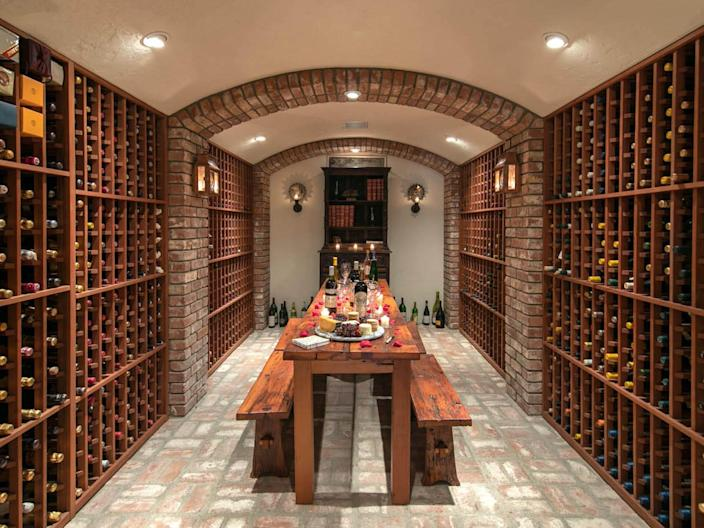 a wine cellar surrounded by brick walls and floors