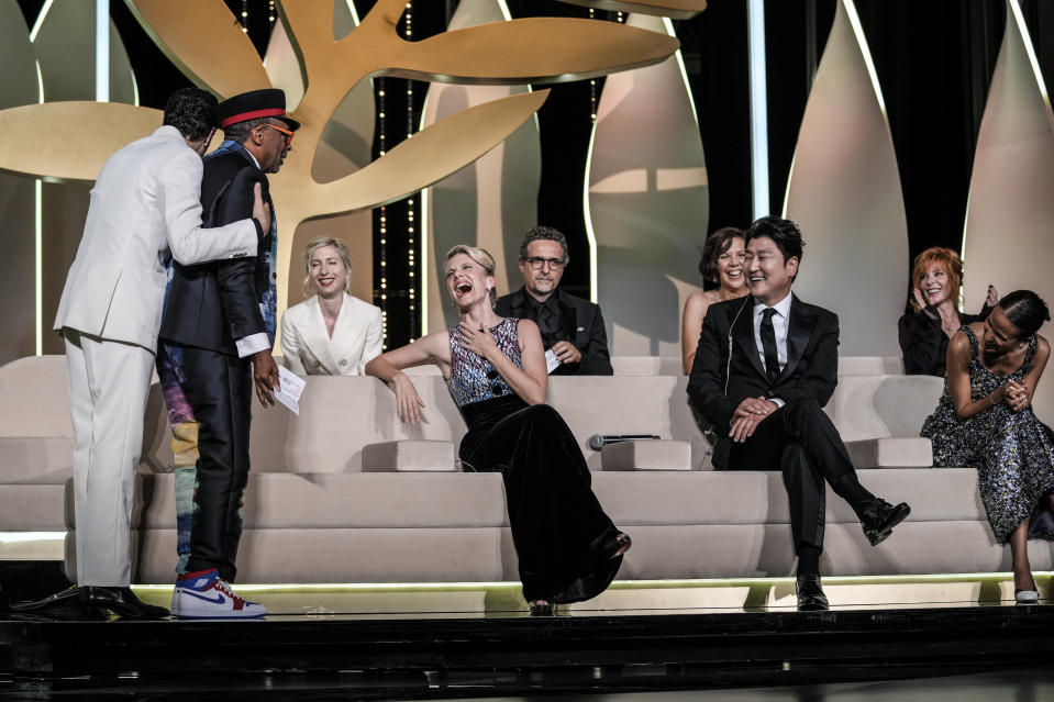 FILE - In this July 17, 2021 file photo Jury president Spike Lee, second from left, accidentally reveals the film 'Titane' as the winner of the Palme d'Or as jury members Tahar Rahim, from left, Jessica Hausner, Melanie Laurent Kleber Mendonca Filho, Maggie Gyllenhaal, Song Kang-ho, Mylene Farmer, and Mati Diop react during the awards ceremony at the 74th international film festival, Cannes, southern France. (AP Photo/Vadim Ghirda, File)
