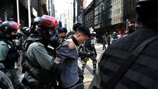 PHOTO: A man (C, in torn shirt) is detained by riot police during a protest in Hong Kong's Central district on November 11, 2019. (Photo by ANTHONY WALLACE/AFP via Getty Images) (Anthony Wallace/AFP via Getty Images)