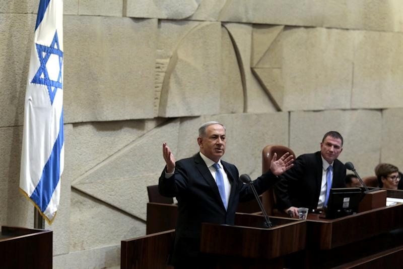 Israeli Prime Minister Benjamin Netanyahu speaks at the Knesset, Israel's parliament, as he presents his proposed government for a confidence vote on May 14, 2015, in Jerusalem (AFP Photo/Jim Hollander)