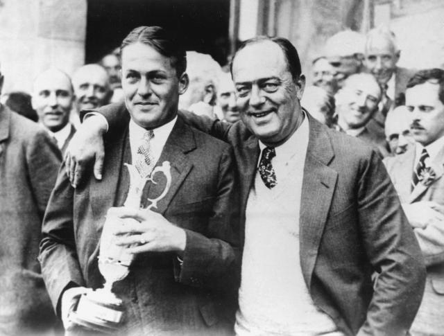 """FILE - In this July 22, 1927, file photo, American amateur Bobby Jones, left, poses with his father, Robert, after winning the British Open at St. Andrews, Scotland. Jones not only was the best amateur in U.S. Open history, he remains one of the greatest to ever play the game and is celebrated for his """"impregnable quadrilateral"""" _ the Grand Slam _ by winning the U.S. Open, British Open, British Amateur and U.S. Amateur in 1930. (AP Photo/File)"""