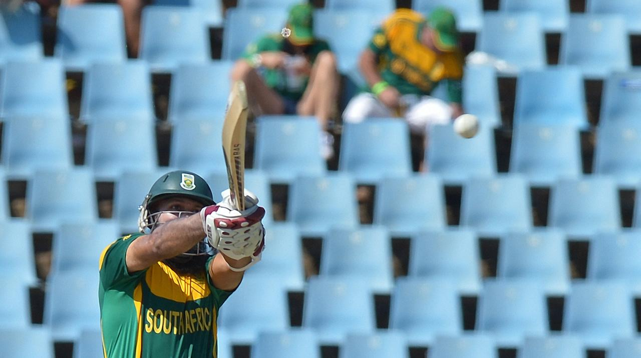 South Africa's batsman Hashim Amla, swings at  shot  during  the final One-Day International (ODI ) match  between South Africa and Pakistan at SuperSport in Centurion on November 30, 2013.  AFP PHOTO / ALEXANDER JOE