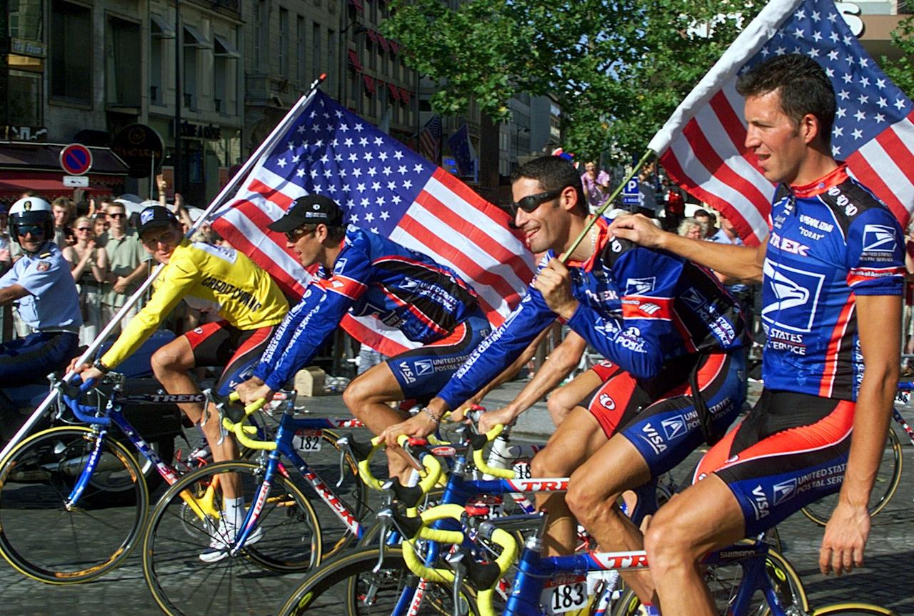 FILE - This July 25, 1999, file photo shows Tour de France winner Lance Armstrong of the U.S. left, riding down the Champs Elysees avenue with teammates, from left, Frankie Andreu, of the U.S., George Hincapie of the U.S., and Pascal Derame, of France, after the 20th and final stage of the Tour de France cycling race, in Paris. Armstrong, the superstar cyclist, whose stirring victories after his comeback from cancer helped him transcend sports, chose not to pursue arbitration in the drug case brought against him by the U.S. Anti-Doping Agency. That was his last option in his bitter fight with USADA and his decision set the stage for the titles to be stripped and his name to be all but wiped from the record books of the sport he once ruled. (AP Photo/Laurent Rebours, File)