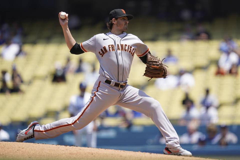 San Francisco Giants starting pitcher Kevin Gausman (34) throws during the first inning of a baseball game against the Los Angeles Dodgers Sunday, May 30, 2021, in Los Angeles. (AP Photo/Ashley Landis)