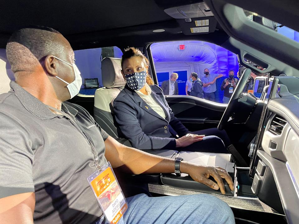 Gov. Gretchen Whitmer learns about the features in the F-150 Lightning from Ford's Dapo Adewusi at MOtor Bella in Pontiac on Tuesday.