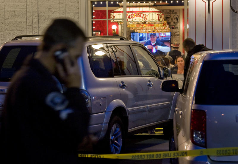 Police investigate a fatal parking lot accident in which a man in his 70's driving an SUV lost control and drove into a line of people waiting to enter Farrell's Ice Cream Parlour in Buena Park Friday April 25, 2014. One woman was pronounced dead after being taken to UCI Medical Center in Orange and six other people were injured in the accident. (AP Photo/The Orange County Register, Paul Rodriguez)