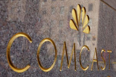 FILE PHOTO: The NBC and Comcast logos are displayed on 30 Rockefeller Plaza in midtown Manhattan in New York, U.S., February 27, 2018. REUTERS/Lucas Jackson