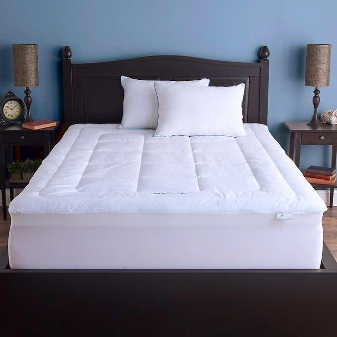 """<p><strong>Sleep Better</strong></p><p>costco.com</p><p><strong>$169.99</strong></p><p><a href=""""https://www.costco.com/.product.11748782.html"""" rel=""""nofollow noopener"""" target=""""_blank"""" data-ylk=""""slk:Shop Now"""" class=""""link rapid-noclick-resp"""">Shop Now</a></p><p>This mattress pad uses Outlast technology to prevent you from over heating at night. The topper is made from low density memory foam, so it is <strong>softer than traditional memory foam for a more plush feel</strong>. There's also a polyester fiberfill top and a cotton cover for extra plush. Reviewers love that the stretchy fabric on the sides make it super easy to secure this topper to your mattress.</p>"""