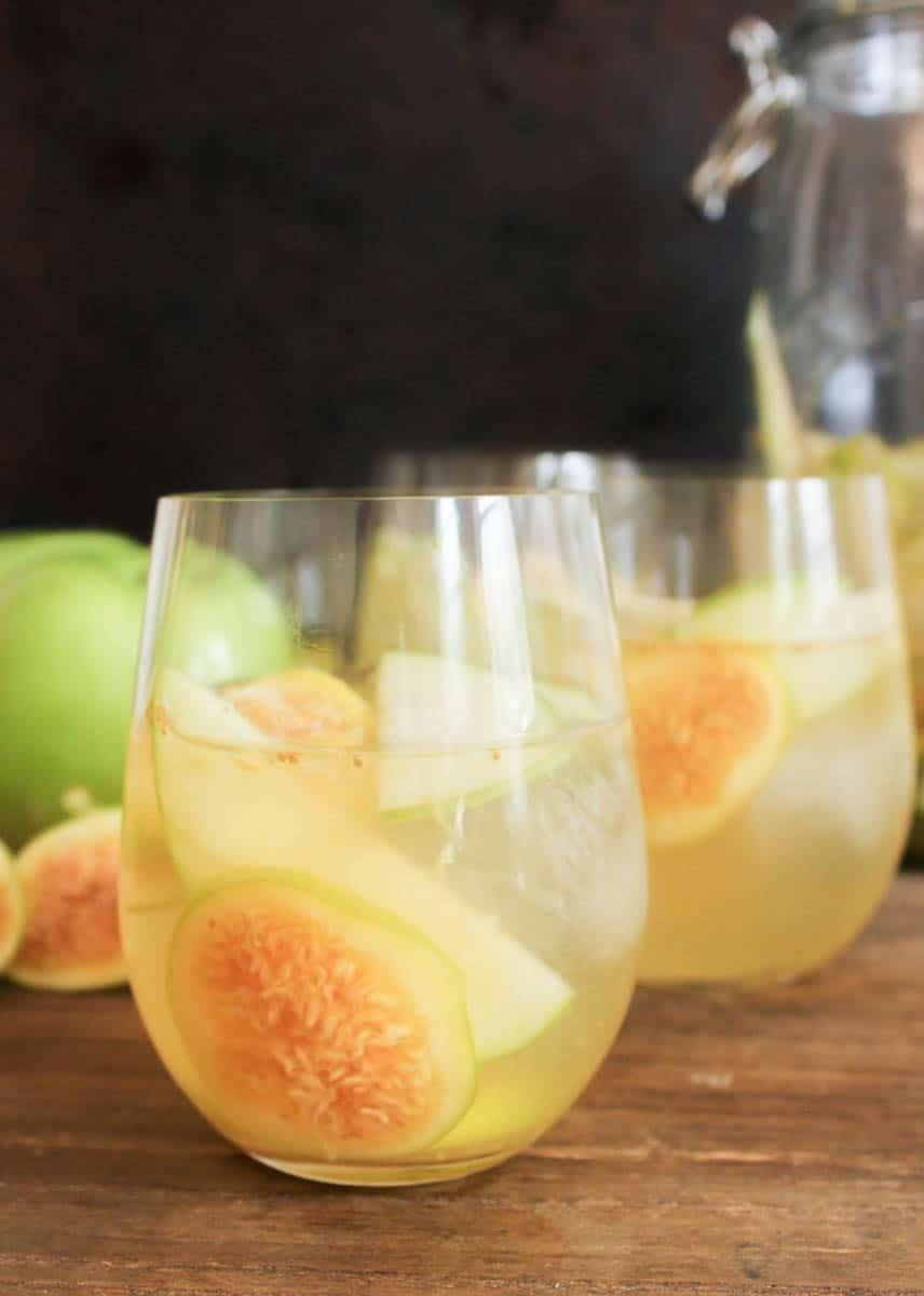 """<p>This unique sangria boasts fig, apple, and lemon flavors for an unforgettable sip. Make sure you have a bottle of Prosecco handy for this light, delicious punch!</p><p><strong>Get the recipe at <a href=""""https://domesticate-me.com/casual-friday-sparkling-fig-and-apple-sangria/"""" rel=""""nofollow noopener"""" target=""""_blank"""" data-ylk=""""slk:Domesticate Me"""" class=""""link rapid-noclick-resp"""">Domesticate Me</a>. </strong></p><p><a class=""""link rapid-noclick-resp"""" href=""""https://www.amazon.com/DOQAUS-Easy-Release-Spill-Resistant-Removable-Certified/dp/B088CR8NMD/?tag=syn-yahoo-20&ascsubtag=%5Bartid%7C2164.g.36792938%5Bsrc%7Cyahoo-us"""" rel=""""nofollow noopener"""" target=""""_blank"""" data-ylk=""""slk:SHOP ICE CUBE TRAYS"""">SHOP ICE CUBE TRAYS</a><br></p>"""