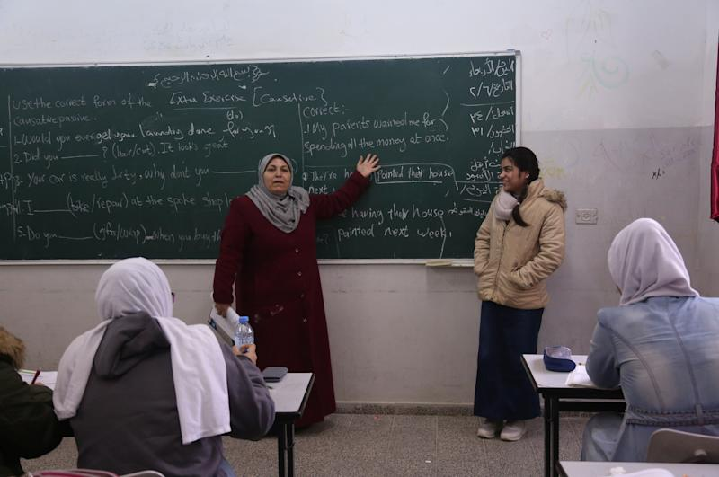 "Fatma Youssef, 17, a Palestinian high school student and a horse rider, stands at the front of the class during an English language lesson at her school in Gaza City, Feb. 7, 2019. ""I'm nervous because this is my final high school year, but when I ride my horse I become free of stress,"" Youssef said. (Photo: Samar Abo Elouf/Reuters)"