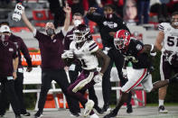 Mississippi State wide receiver Jaden Walley (31) heads for a touchdown as Georgia defensive back Mark Webb (23) trails during the first half of an NCAA college football game Saturday, Nov. 21, 2020, in Athens, Ga. (AP Photo/Brynn Anderson)