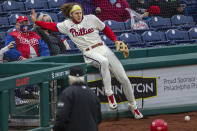 Philadelphia Phillies third baseman Alec Bohm (28) falls into the nets trying to catch a foul ball from St. Louis Cardinals' Dylan Carlson (3) during the sixth inning of a baseball game, Saturday, April 17, 2021, in Philadelphia. (AP Photo/Laurence Kesterson)