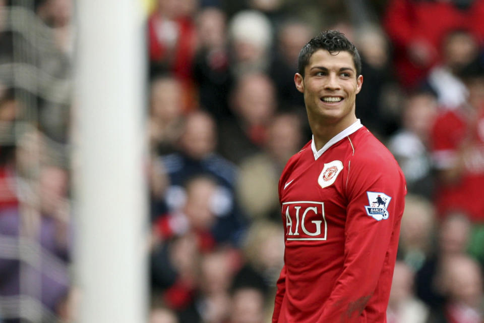 FILE - In this March 17, 2007, file photo, Manchester United's Cristiano Ronaldo smiles during his team's 4-1 win over Bolton Wanderers in their English Premier League soccer match at Old Trafford Stadium, Manchester, England. Ronaldo is headed back to Manchester United. The English club said Friday, Aug. 27, 2021, it has reached an agreement with Juventus for the transfer of the 36-year-old Portugal forward, subject to agreement of personal terms, visa and a medical examination. (AP Photo/Jon Super, File)