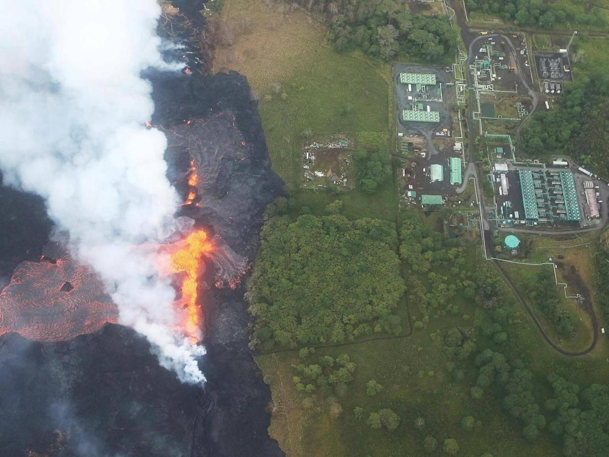 Lava flows from a Kilauea volcano fissure towards the Puna Geothermal Venture plant (Getty Images)