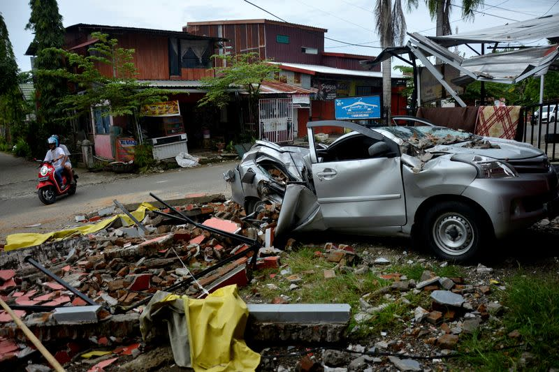 A damaged car is seen among the ruins following an earthquake in Mamuju