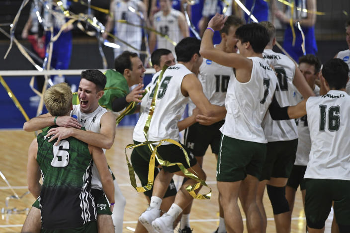 Hawaii's Spyros Chakas (back) and Gage Worsley (6) celebrate after Hawaii defeated BYU in the final of the NCAA men's volleyball tournament Saturday, May 8, 2021, in Columbus, Ohio. (AP Photo/David Dermer)