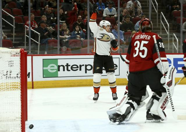Anaheim Ducks right wing Jakob Silfverberg, left, celebrates his goal against Arizona Coyotes goaltender Darcy Kuemper (35) during the first period of an NHL hockey game Tuesday, March 5, 2019, in Glendale, Ariz. (AP Photo/Ross D. Franklin)