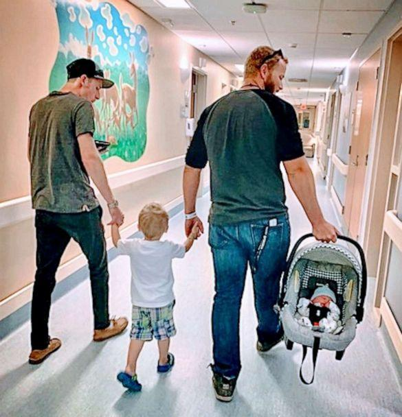 PHOTO: Madison Holley of Corunna, Ontario, shared an image of her former partner and current fiance exiting the hospital hand-in-hand with her toddler son, along with her newborn (Madison Holley)
