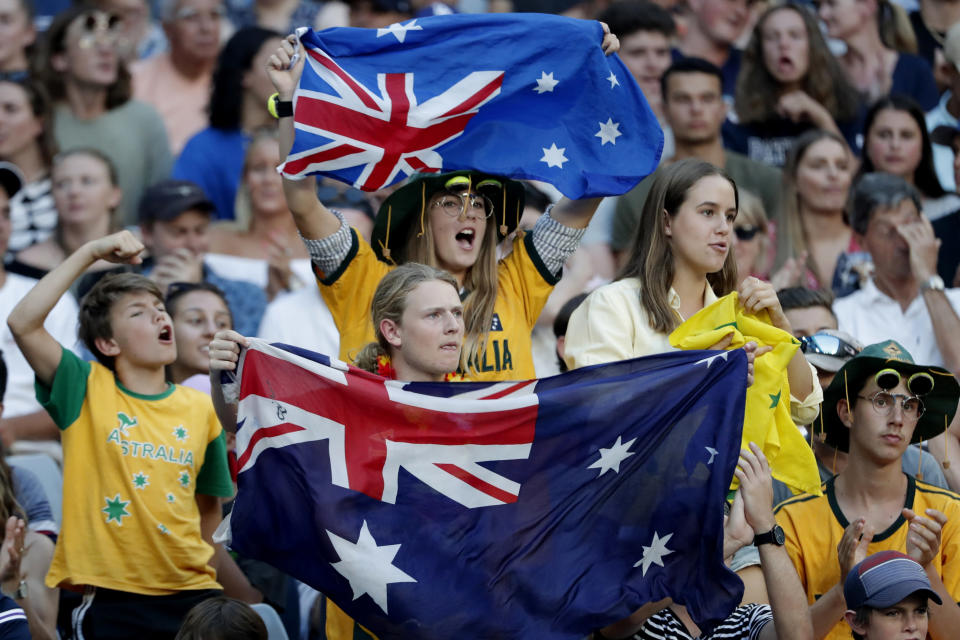 FILE - In this Jan. 17, 2018, file photo, fans cheer on Australia's Nick Kyrgios during a match against Serbia's Viktor Troicki in the second round at the Australian Open tennis championships in Melbourne, Australia. The head of the Australian Open says various contingency plans are being considered for the Grand Slam tournament scheduled for January 2021. They include scrapping it altogether because of the coronavirus pandemic or allowing just spectators from the host country. (AP Photo/Vincent Thian)