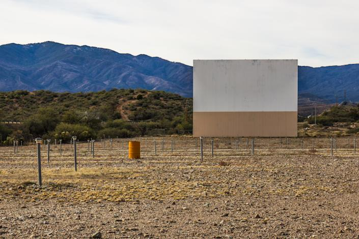 Abandoned Old Style Drive In Movie Theater With Screen