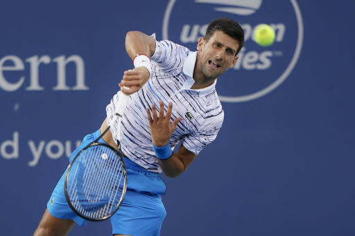 Novak Djokovic, of Serbia, serves to Pablo Carreno Busta, of Spain, during the quarterfinals of the Western & Southern Open tennis tournament Thursday, Aug. 15, 2019, in Mason, Ohio. (AP Photo/John Minchillo)