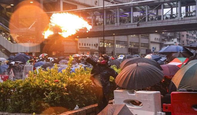Anti-government protesters throw petrol bombs at police as tensions rise in Tsuen Wan. Photo: Dickson Lee