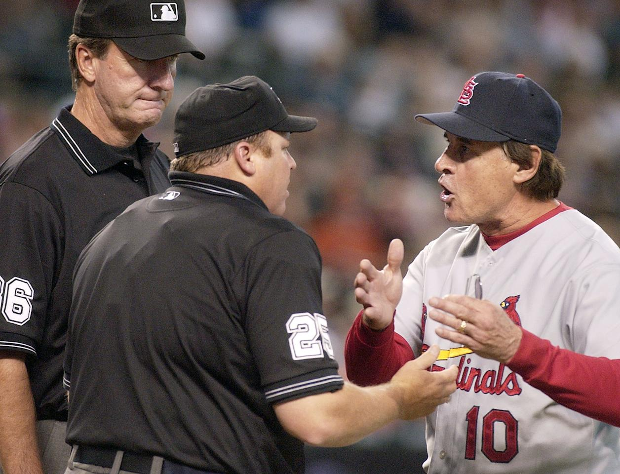 St. Louis Cardinals manager Tony La Russa, right, argues with home plate umpire Fieldin Culbreth (25) and third base umpire Tim McClelland, left, after being thrown out of the baseball game for arguing balls and strikes during the fifth inning against the Arizona Diamondbacks on Sunday, Sept. 10, 2006, in Phoenix. (AP Photo/Tom Hood)