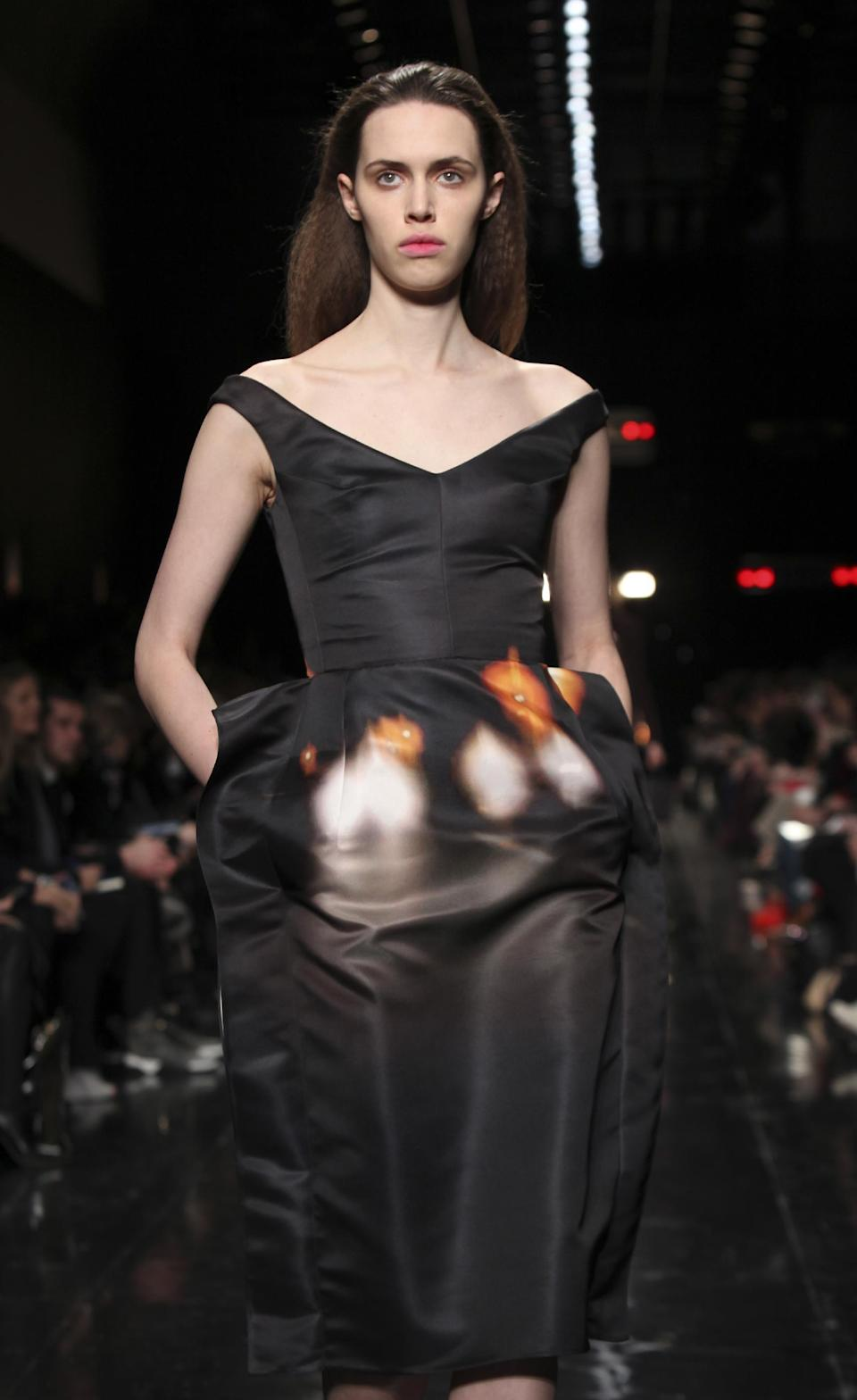 A model presents a creation by French fashion designer Guillaume Henry for Carven Ready to Wear's Fall-Winter 2013-2014 fashion collection, presented, Thursday, Feb.28, 2013 in Paris. (AP Photo/Thibault Camus)