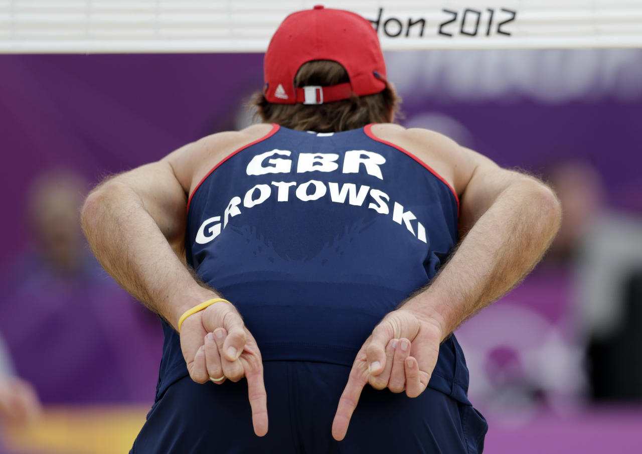Great Britian's Steven Grotowski signals his partner during a beach volleyball match against Canada at the 2012 Summer Olympics, Saturday, July 28, 2012, in London. (AP Photo/Dave Martin)