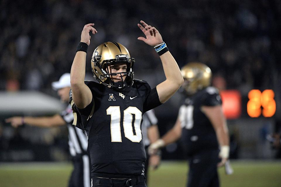Central Florida quarterback McKenzie Milton (10) encourages the fans in the stands during the second half of an NCAA college football game against Cincinnati Saturday, Nov. 17, 2018, in Orlando, Fla. (AP Photo/Phelan M. Ebenhack)