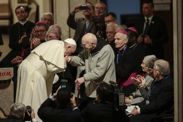 Pope Francis greets father Jean-Pierre Schumacher, a French monk who survived the Tibhirine killing, when seven Trappist monks and 12 other Catholics were kidnapped from the monastery of Tibhirine, south of Algiers in 1996 and killed, in the Rabat Cathedral, Morocco, Sunday, March 31, 2019. Pope Francis is in Morocco for a two-day trip aimed at highlighting the North African nation's Christian-Muslim ties, while also showing solidarity with migrants at Europe's door and tending to a tiny Catholic flock. (AP Photo/Mosa'ab Elshamy)