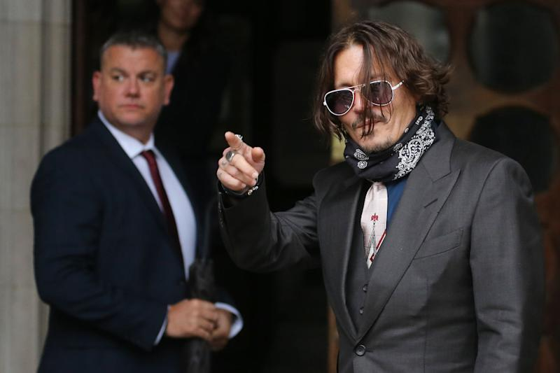 Mr Depp is suing the publisher of The Sun for libel (AFP via Getty Images)
